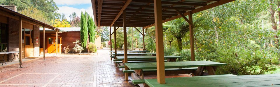 Outdoor picnic tables at Camp Toolangi